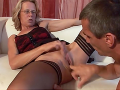 Mature blonde's fucked by her husband in the living room