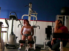 Red hot pornstar Roxy Lane wearing tight shorts while working out