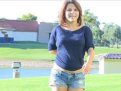 This short-haired cutie strips down to her denim shorts in the park