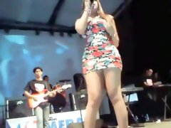 Upskirt of a girl singing on the stage