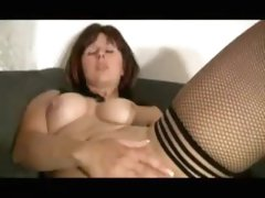 Pierced german MILF in boots uses a cucumber