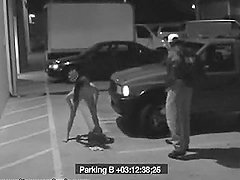 A girl gives a blowjob at the parking lot and goes away