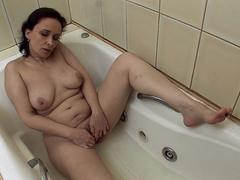 MILF brunette babe wants to finger her cunt in a bathroom