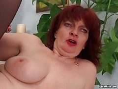 Redhead granny practicing anal sex