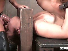 Locked in stocks submissive Ziggy Star gets fucked hard with strapon