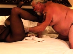 Seductive Oriental ladyboy getting fisted by a chubby guy