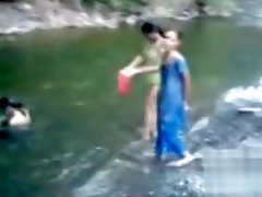 Naked Indian amateur teen swims in the river