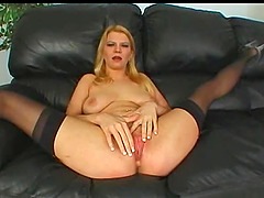Chick with a red beaver having a nice threesome on the black sofa