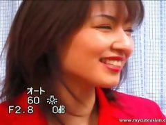 Slim Asian hooker takes off her red suit to display her sexy body