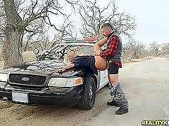 Slutty lady cop bent over her car and fucked from behind