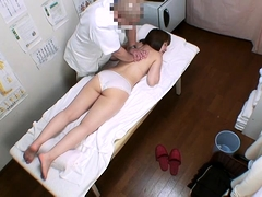 Buxom Asian babe enjoys strong orgasms on the massage table