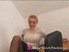 Busty secretary stripping