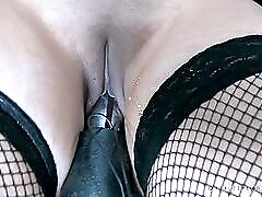 Weights hang off the nipples of a pierced girl