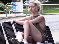 Pretty blonde teen exposes her tight slit in a public place