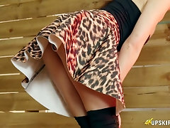 Sizzling milf Tina Kay shows off her peachy pussy upskirt