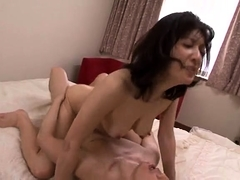 Lustful Oriental lady has a young man fulfilling her needs