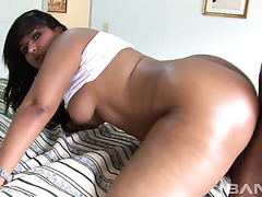 Big buttoned black mommy Santana got her cooch pleased in doggy and cowgirl poses