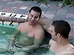 Gay guys suck dick and fuck in the pool