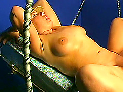 Solo babe with natural tits gets her shaved pussy drilled by a machine in close up
