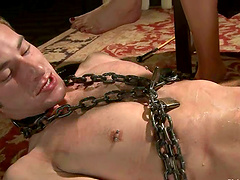 Ms Kim bondages Nomad in chain and gives him a footjob
