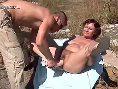 Chubby mature sucks and fucks a large cock outdoors