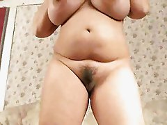 Huge tits on the curvy natural brunette