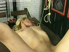Horny slave gets her nipples of her tiny tits tied with a rope and gets heavy weights on them by her master